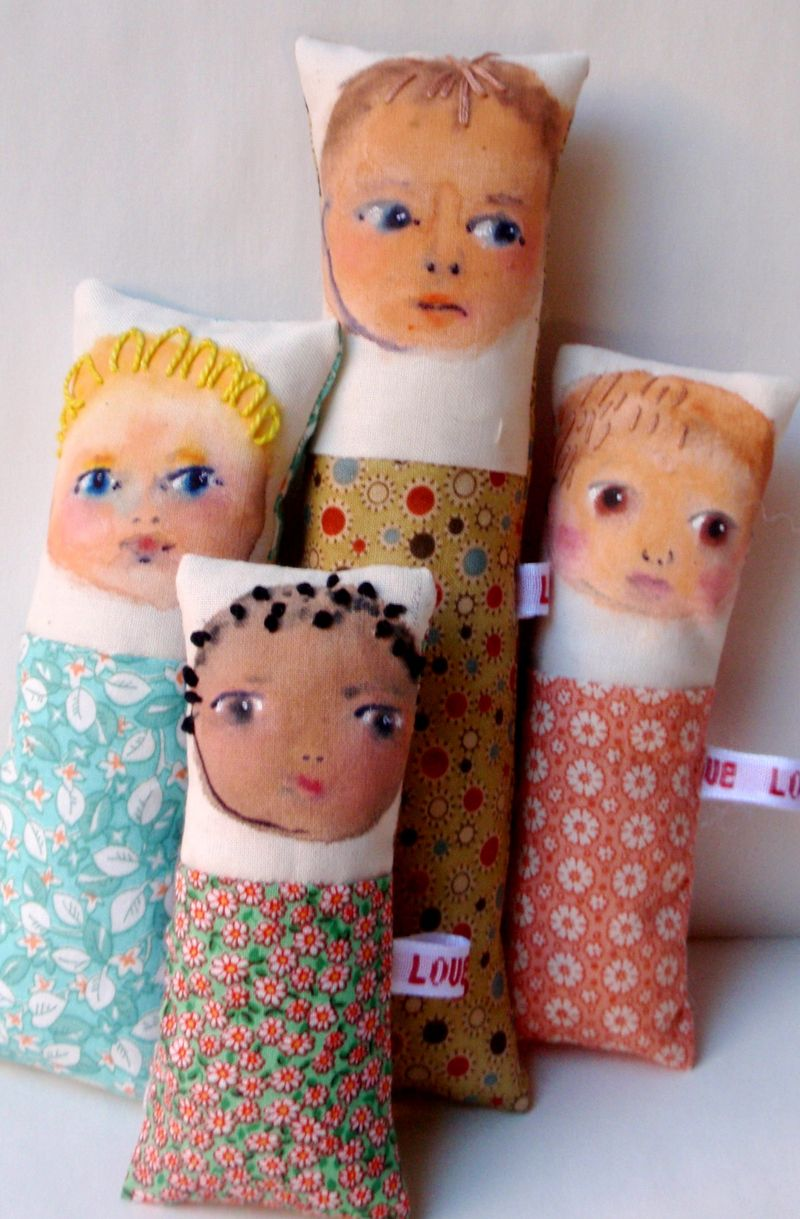 Four children dolls