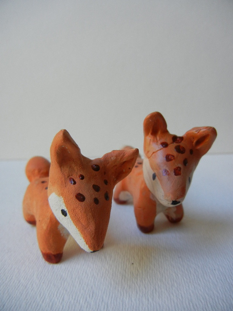 Two Foxes, left paperclay, right polymer clay